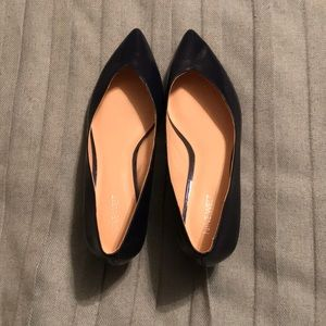 Navy blue leather wedge pumps.
